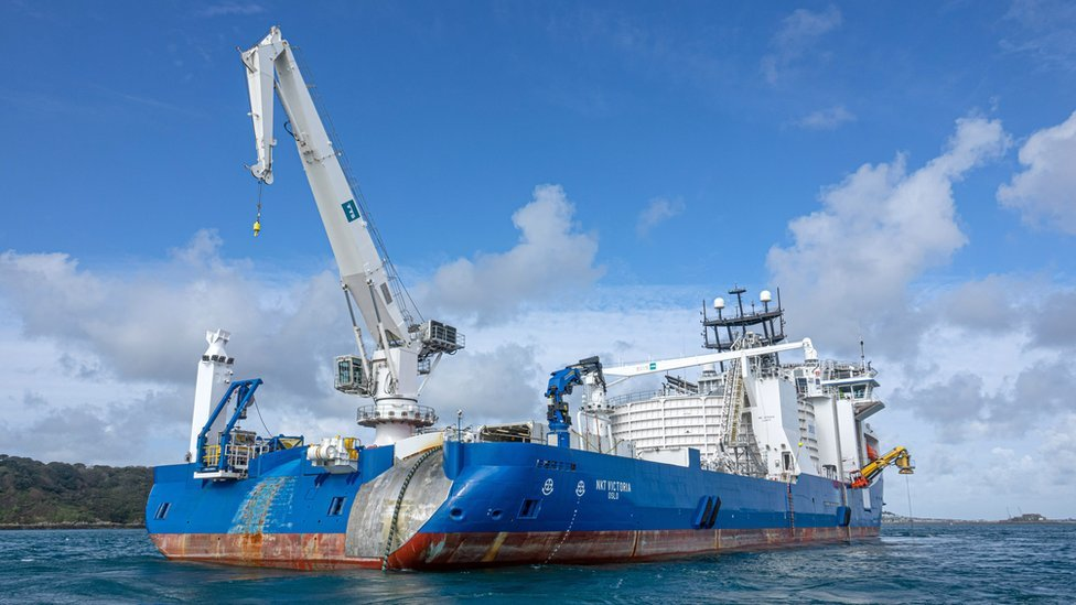 Cable laying ship.