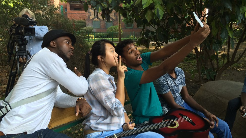 Lu Cheng with taking a 'selfie' with Zambian friends