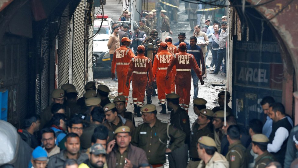 "Members of India""s National Disaster Response Force (NDRF) head towards the site of the fire"