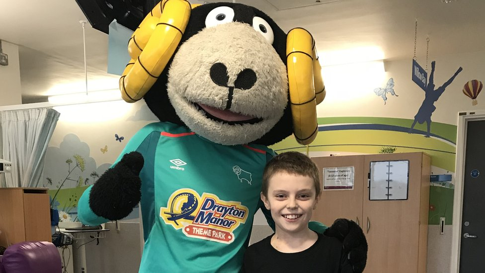 Taylor, pictured with Derby County FC mascot, Rammie