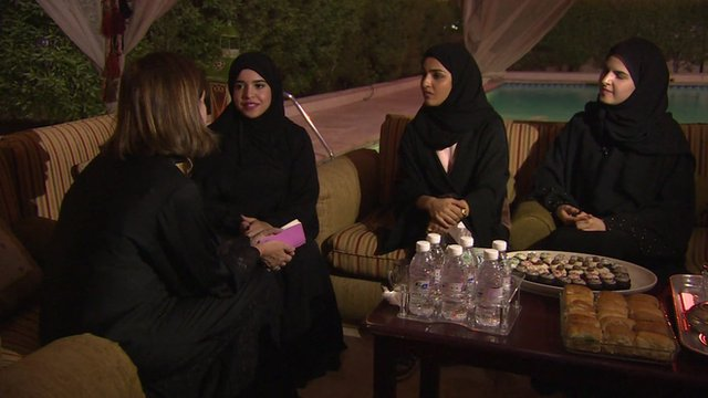 Lyse Doucet with three young Saudi women