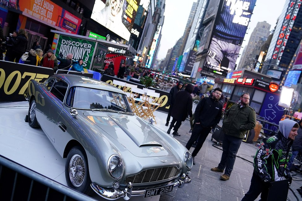An Aston Martin DB5 is pictured during a promotional appearance on TV in Times Square for the James Bond movie No Time to Die