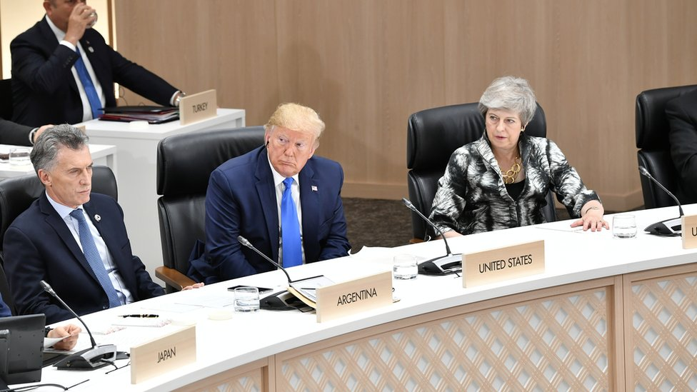 """Britain""""s Prime Minister Theresa May, U.S. President Donald Trump and Argentina""""s President Mauricio Macri attend the closing session of G20 leaders summit in Osaka"""