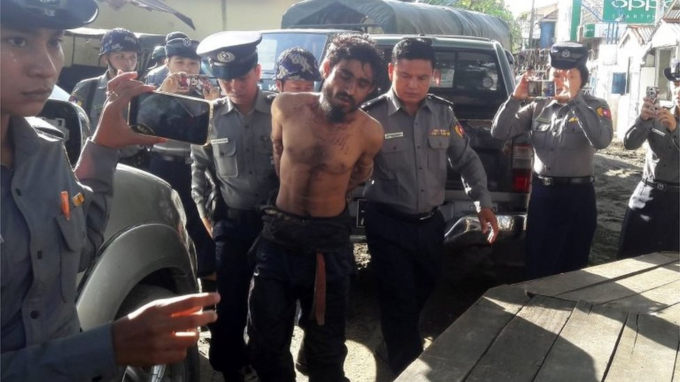 In this photograph taken on October 9, 2016, a man suspected of being one of the attackers in recent border raids is taken to a police station in Sittwe, capital of the Rakhine state.