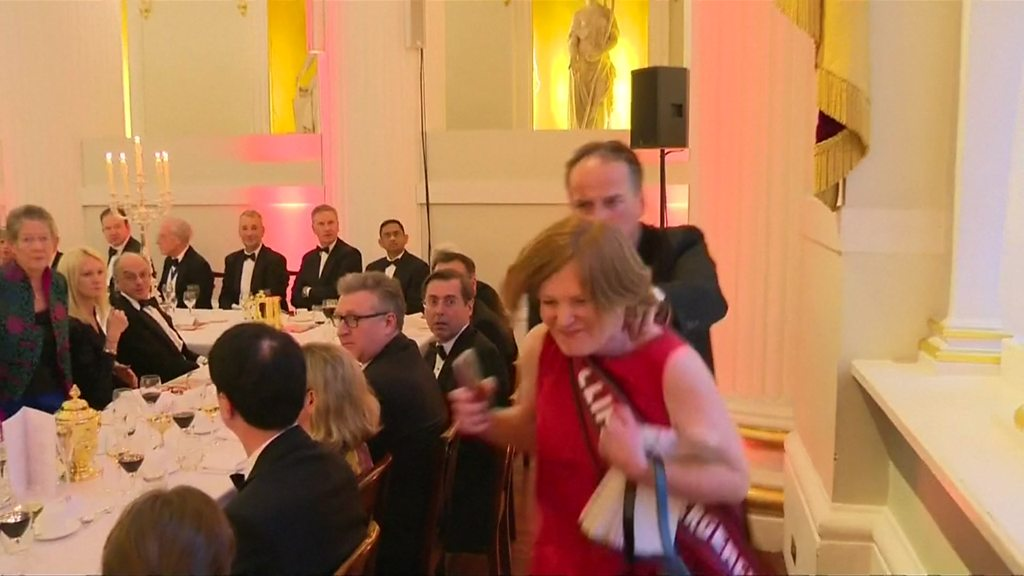 Climate protesters interrupt Hammond's Mansion House speech
