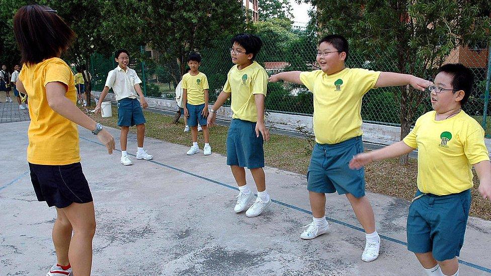Kids exercising in Singapore