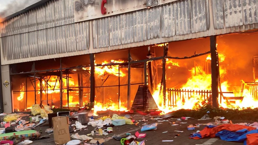A fire engulfs Campsdrift Park, which houses Makro and China Mall, following protests that have widened into looting in Pietermaritzburg, South Africa, 13 July 2021