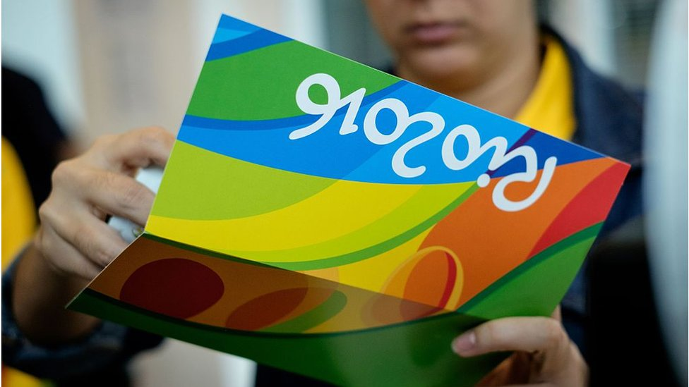 Person holds tickets to Rio Olympics sporting event