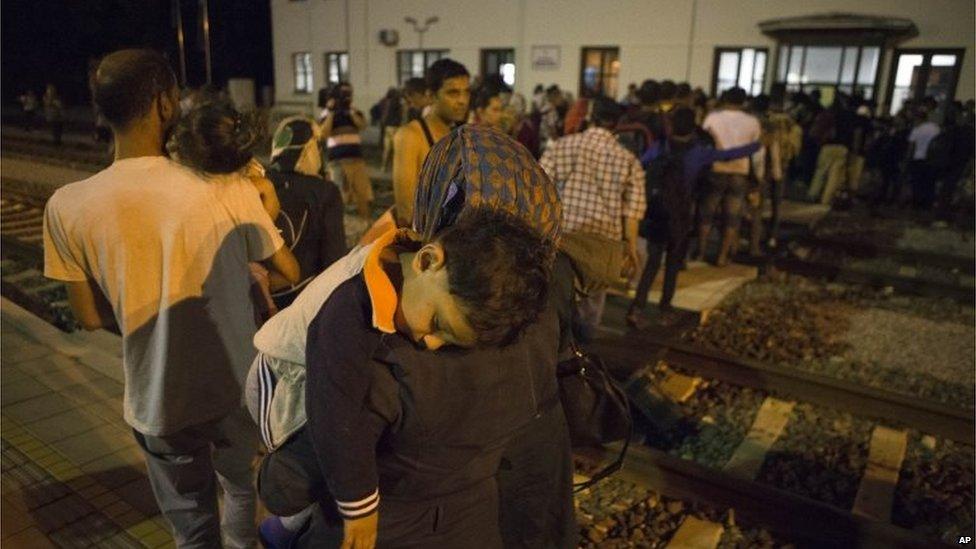 Migrants disembark a train as they arrive at the train station in Beli Manastir, near Hungarian border, northeast Croatia, Thursday, Sept. 17, 2015