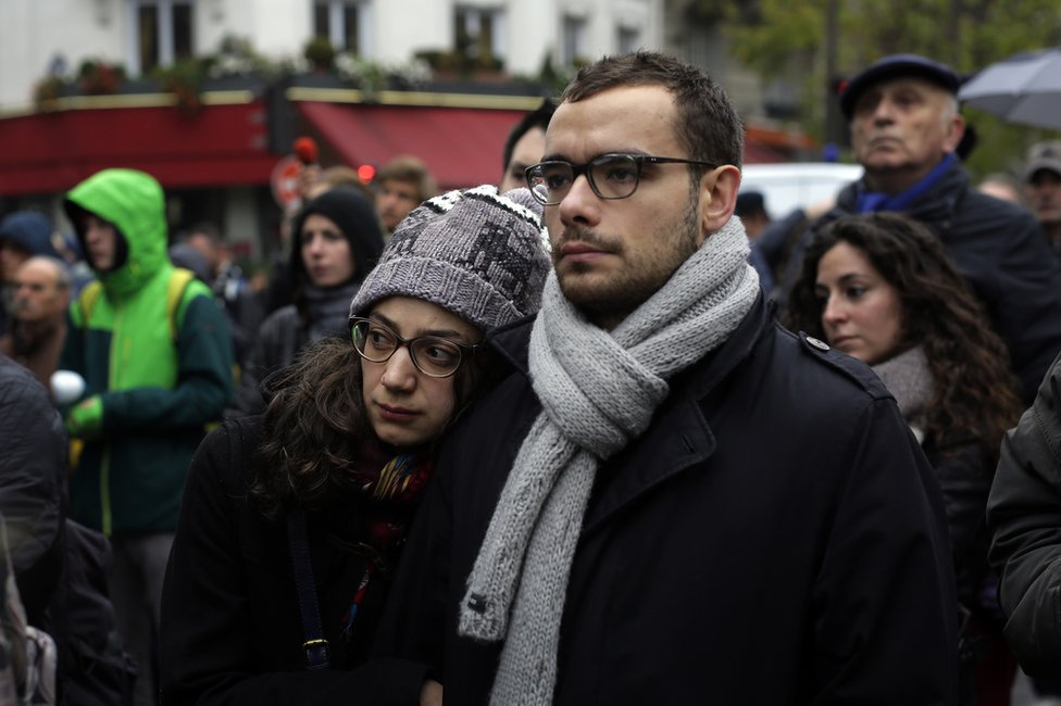 People gather outside the security perimeter set around the Bataclan concert hall in Paris, France, 13 November