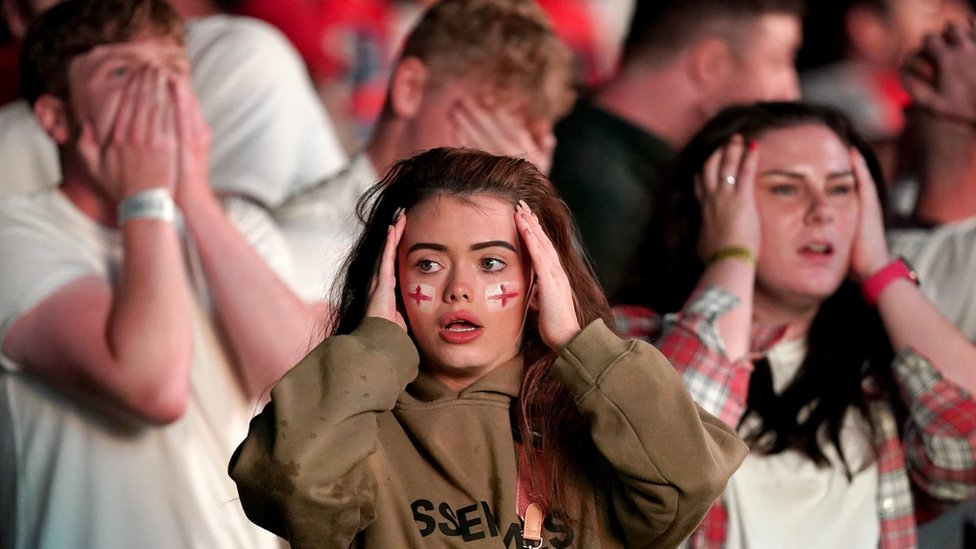 Fans in Manchester react to one of England's missed penalties