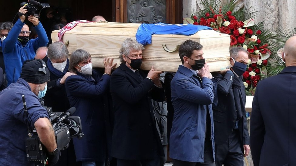 The coffin is carried out of the Santa Maria Annunciata Cathedral after the funeral mass for Paolo Rossi in Vicenza