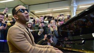 John Legend plays surprise station gig