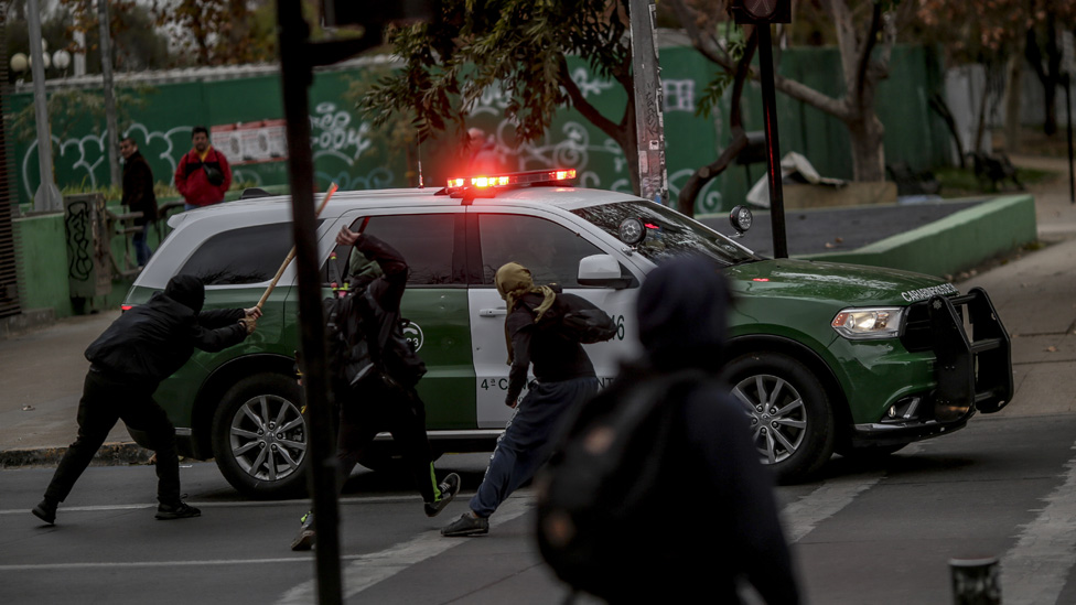 Secondary students face police in the centre of the city of Santiago during the demonstration against the bill promoted by the government of Sebastian Piñera, in Santiago, Chile, on June 24, 2019.