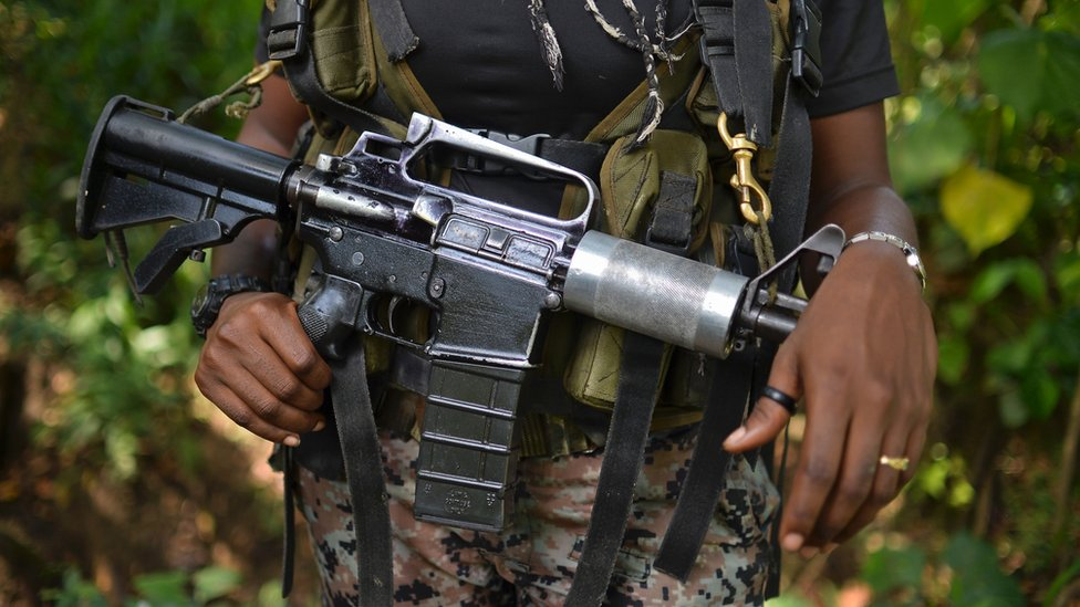 A female guerrilla fighter of the Western Front of War Cimarron Resistance of the National Liberation Army (ELN) guerrilla, stands guard during an interview with AFP, on January 26, 2017, in Alto Baudo