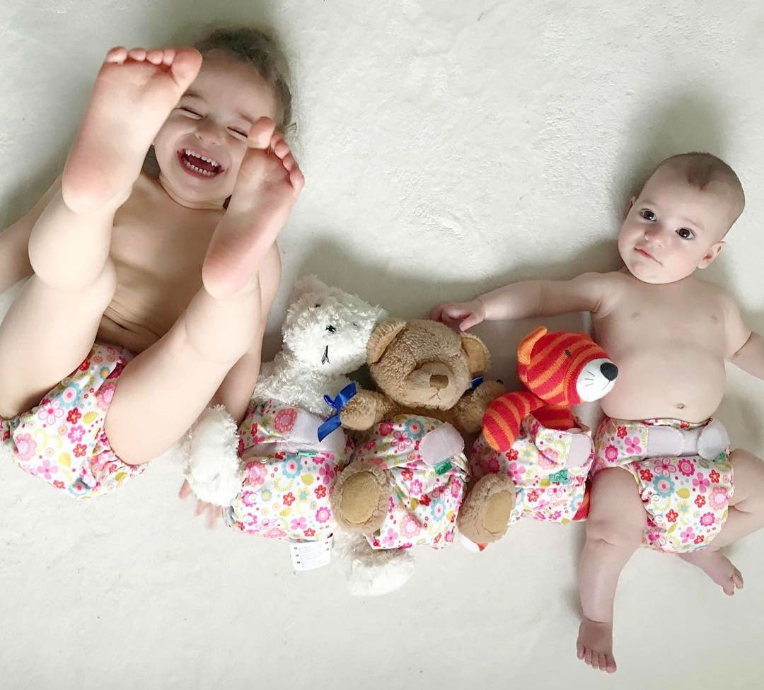 babies and teddies wearing nappies