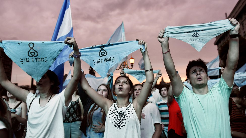 """Protesters against legalising abortion carried signs reading """"two lives"""" and wore crosses"""