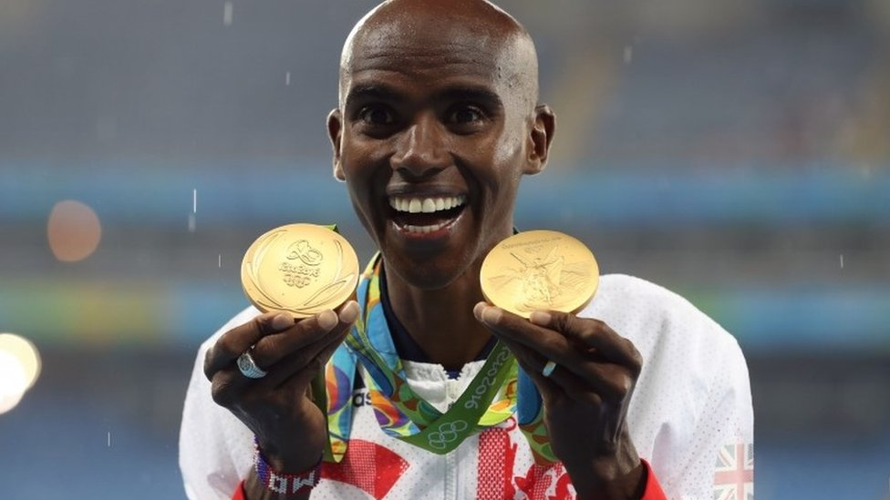 Mo Farah with two gold medals
