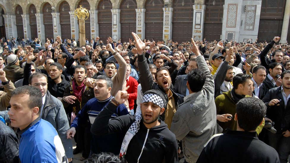 Anti-Assad protesters shout slogans after Friday prayers outside the Umayyad Mosque in Damascus, Syria (25 March 2011)