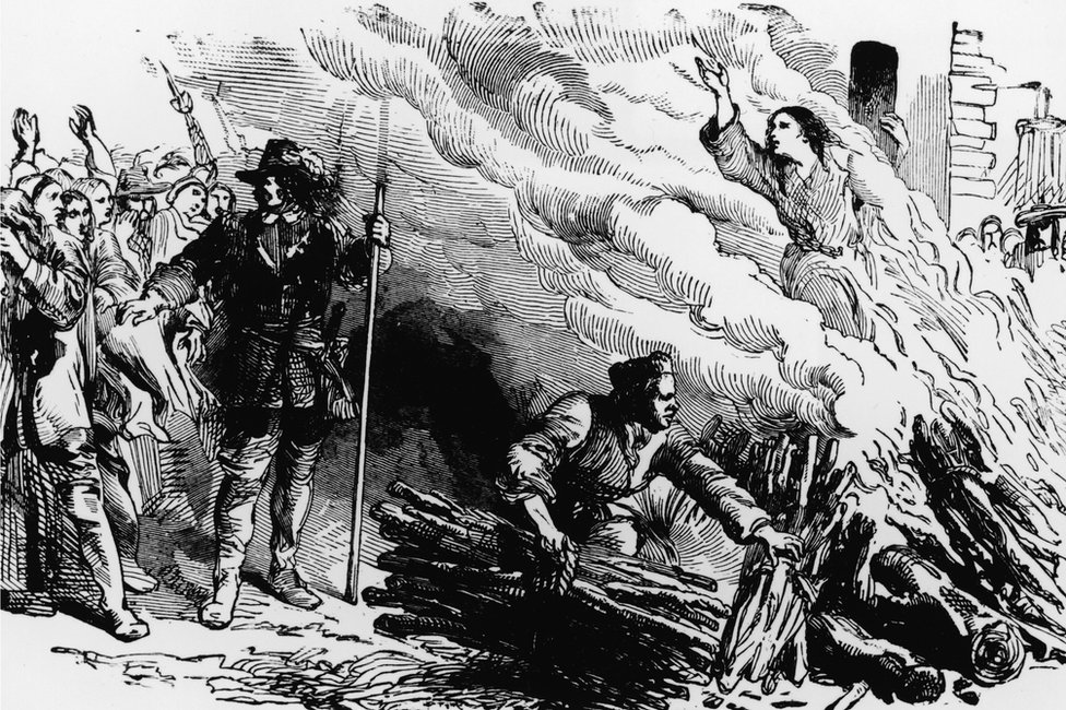 An illustration depicts a woman being burned at the stake for the crime of engaging in witchcraft, circa 1692. (Photo by Kean Collection/Getty Images)