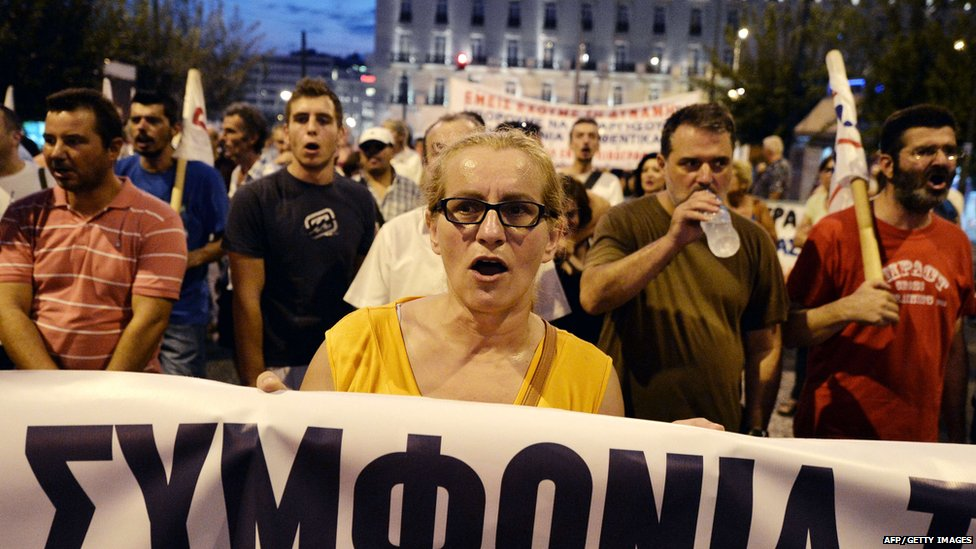 Demonstrators shout slogans in front of the Greek parliament in Athens , during a demonstration against the third bailout agreement on August 13, 2015
