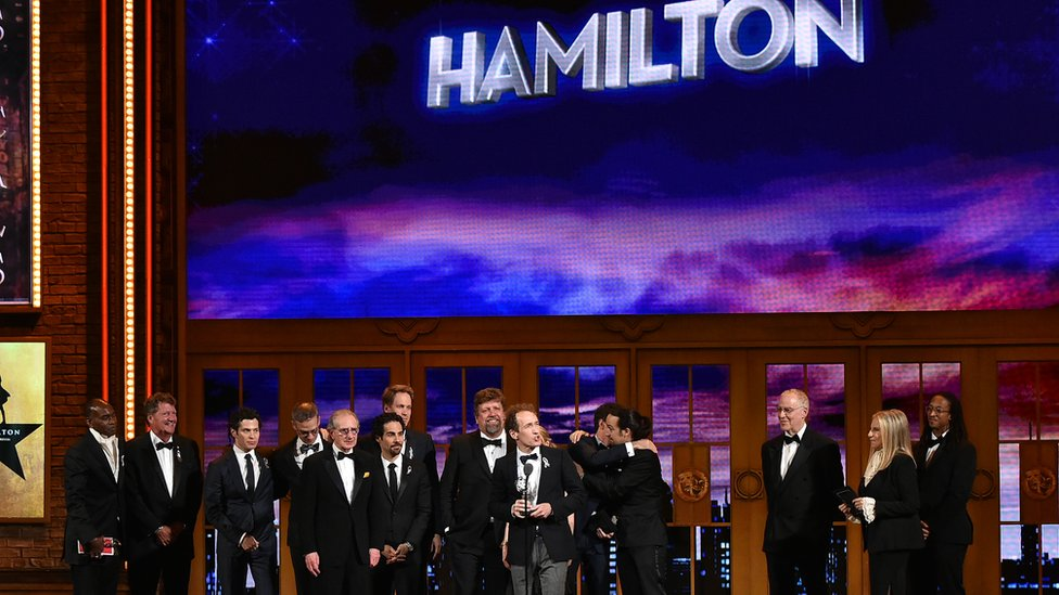The cast of Hamilton - standing together