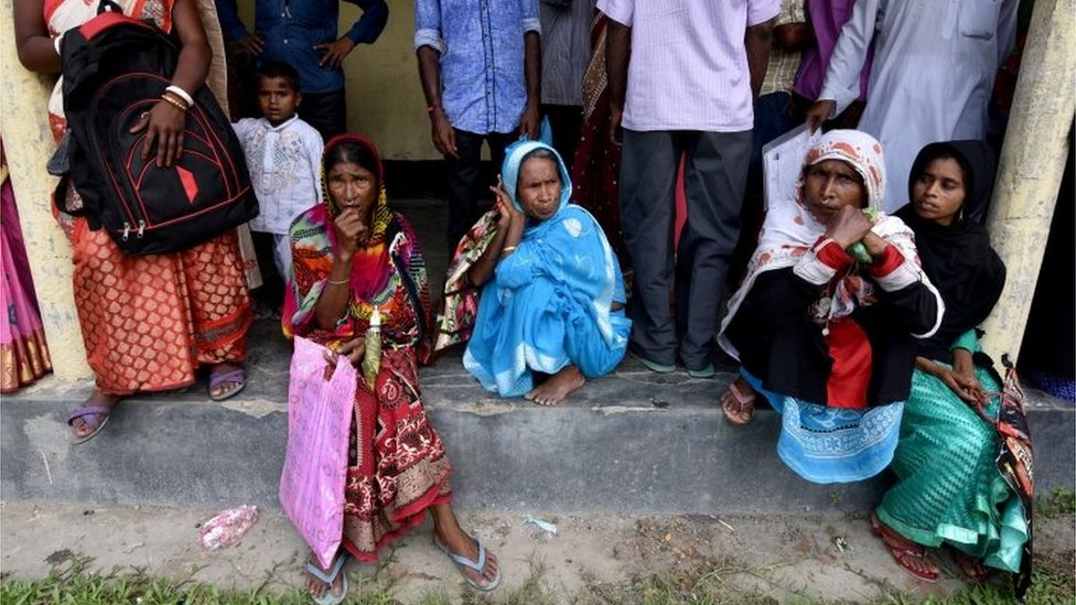 Villagers wait outside the National Register of Citizens (NRC) centre to get their documents verified by government officials, at Mayong Village in Morigaon district, in the northeastern state of Assam, India July 8, 2018.