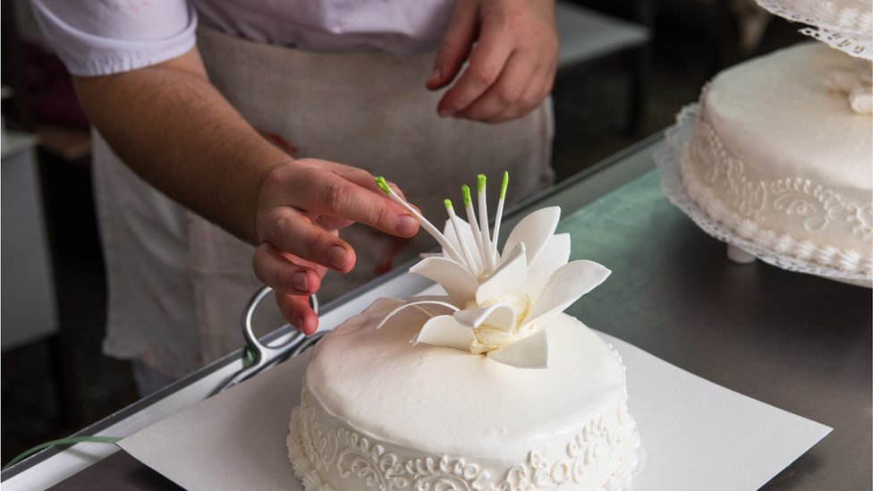 A cake being decorated