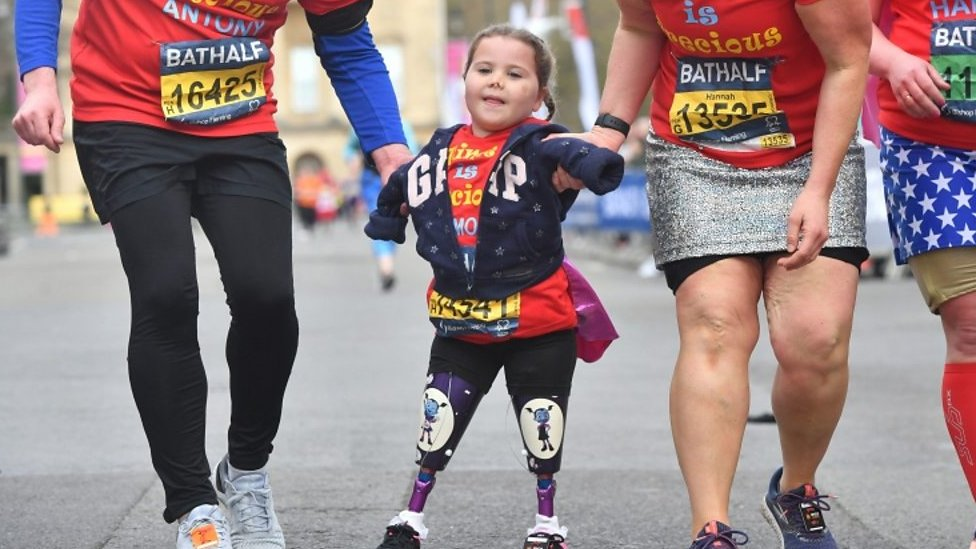 Cheers as limbless girl Harmonie-Rose completes race