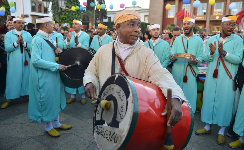 Ahwach musicians perform and celebrate with members of the community on the eve of the 2970th Amazigh New Year near the parliament in the capital of Rabat, Morocco, 12 January 2020