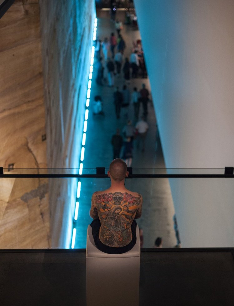 Tim Steiner models his tattoo at mona in Hobart, Australia