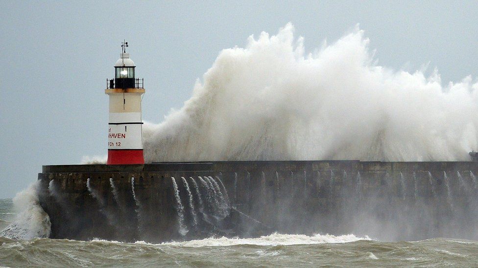 "Waves crash against Newhaven Lighthouse in southern England on December 30, 2015, as ""Storm Frank"" sweeps across Britain"