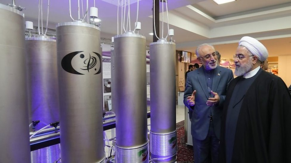 "Iranian President Hassan Rouhan listening to head of Iran's nuclear technology organisation Ali Akbar Salehi during the ""nuclear technology day"" in Tehran on 9 April."