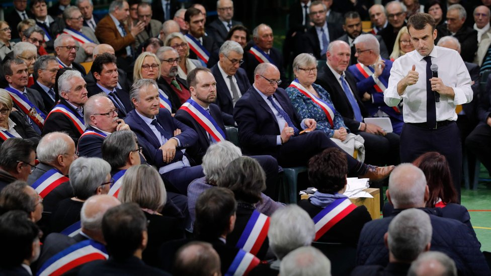 French President Emmanuel Macron speaks during a meeting gathering some 600 mayors who will relay the concerns aired by residents in their towns and villages in the Normandy city of Grand Bourgtheroulde on January 15, 2019