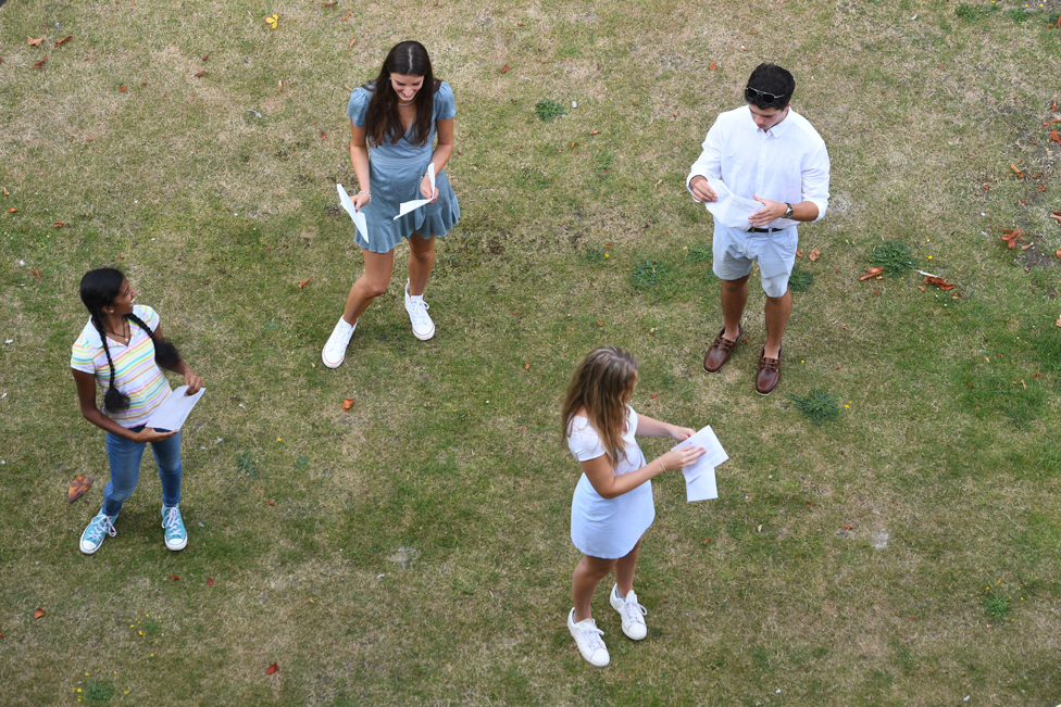 Students practise social distancing as they receive their A-Level results