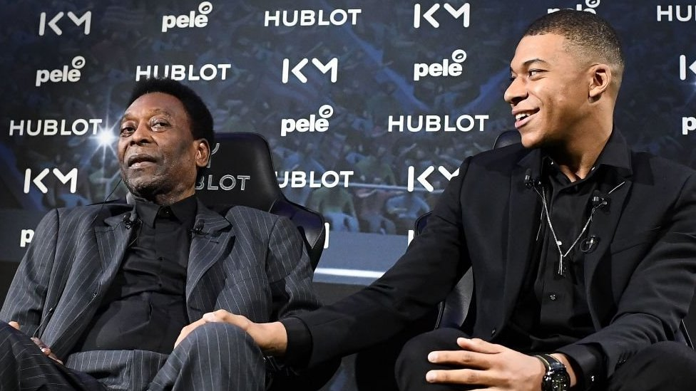Pele (left) and Kylian Mbappe at a promotional event in April 2019