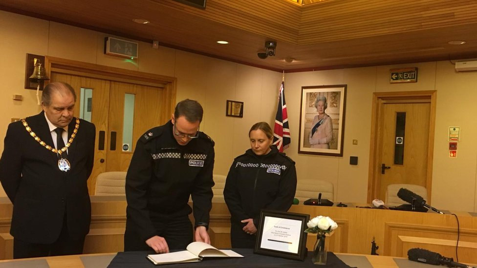 Officers sign book of condolences