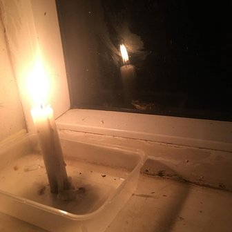 Candlelight in Carmelo Lasam's home