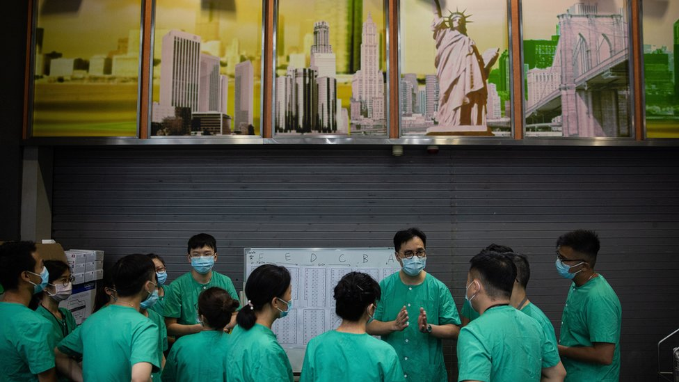 Medical staff work at a temporary facility set up for COVID-19 patients at the AsiaWorld Expo in Hong Kong, China, 01 August 2020.