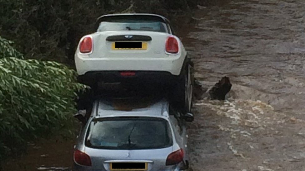 Cars stacked on top of each other in Drumahoe, County Londonderry