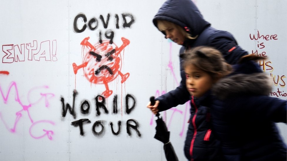 "Graffiti that reads ""Covid 19 World Tour"" in Edinburgh city centre after a range of new restrictions to combat the rise in coronavirus cases came into place in Scotland."