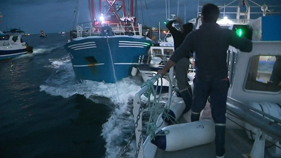 A video screen grab shows fishing boats colliding in the Channel