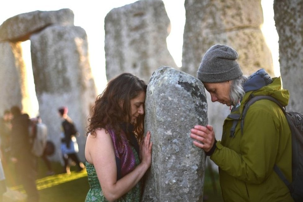Two people at Stonehenge