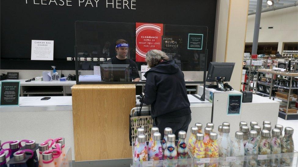 Shopper in John Lewis store