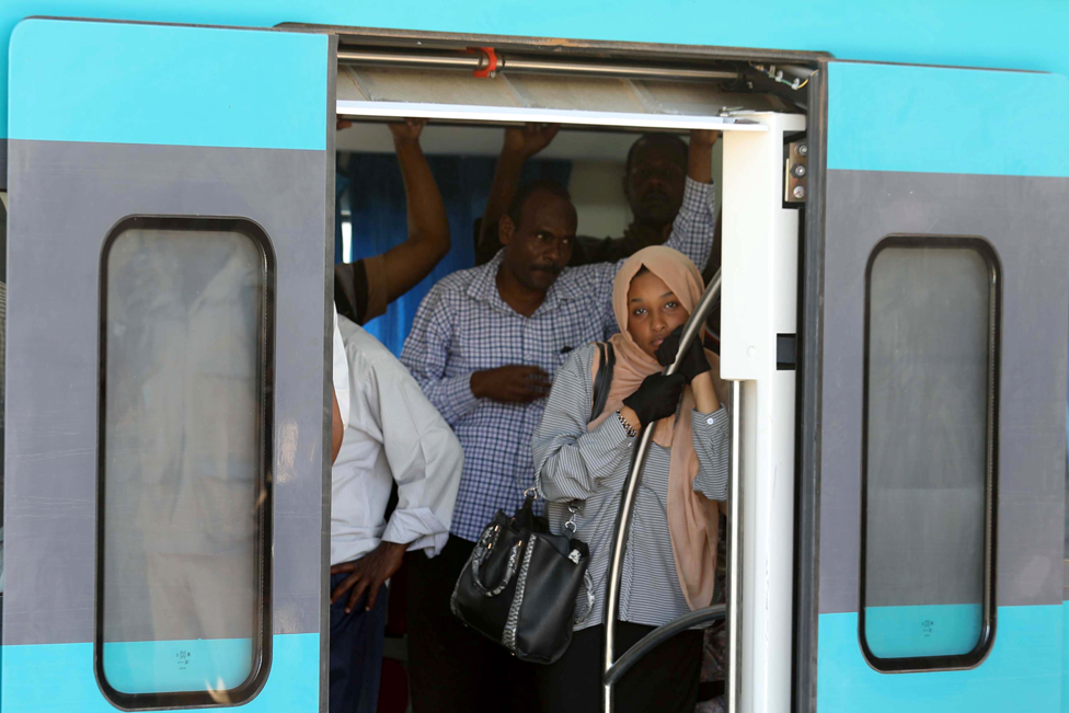 Passengers ride on board a train in Khartoum, Sudan - Tuesday 26 November 2019