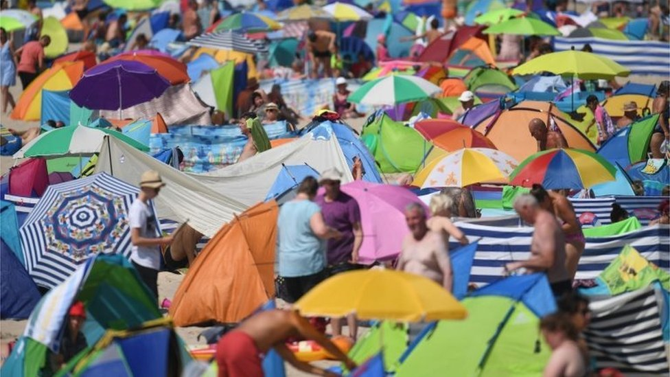 People crowded on to the beach at Zinnowitz on the island of Usedom in the Baltic Sea, northern Germany