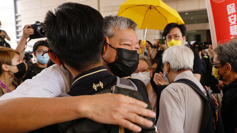 Pro-democracy activist Lee Cheuk-yan hugs a supporter as he arriving at the West Kowloon Courts for verdicts in landmark unlawful assembly case, in Hong Kong, China April 1, 2021. REUTERS/Tyrone Siu