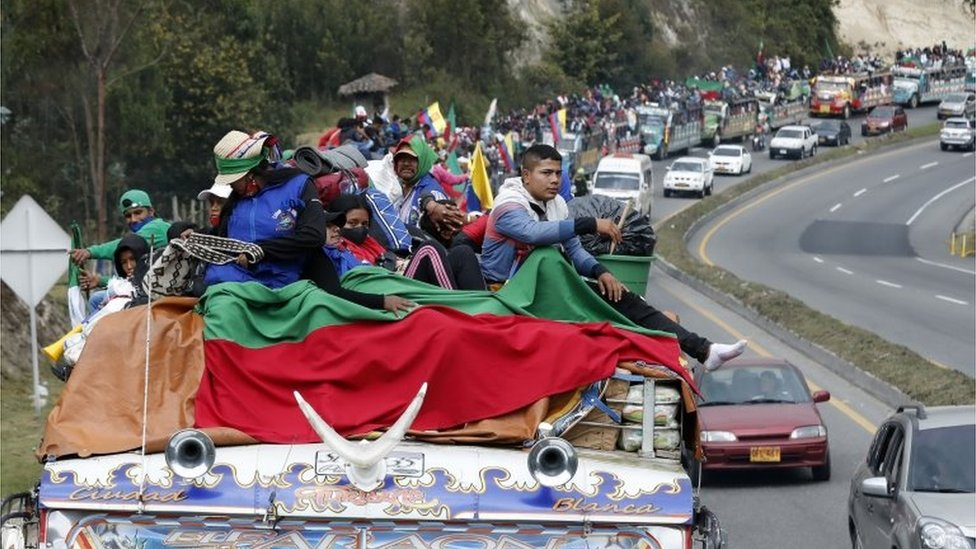 Indigenous people from Cauca region arrive in a buses caravan with the intention of speaking with Colombian President, Ivan Duque, in Soacha, Colombia, 18 October 2020.