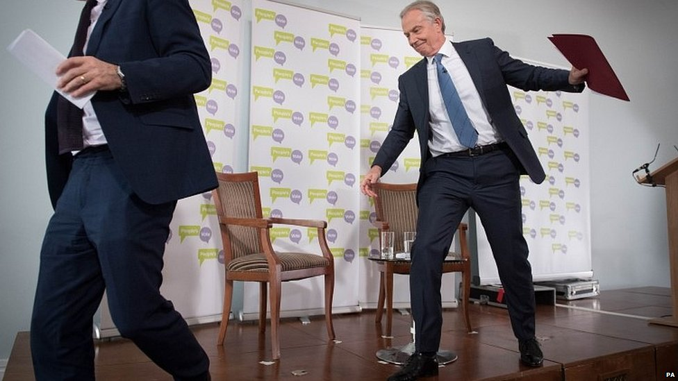 Tony Blair leaving the stage after delivering a speech in London