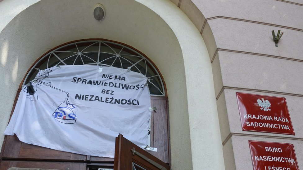 Protest banner outside the national court in Warsaw